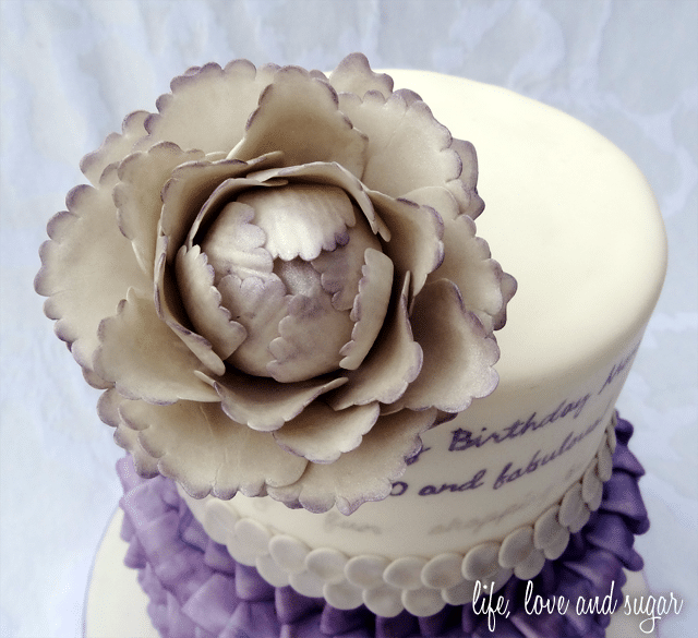 The Purple and White Flower on Top of my Mom's 60th Birthday Cake