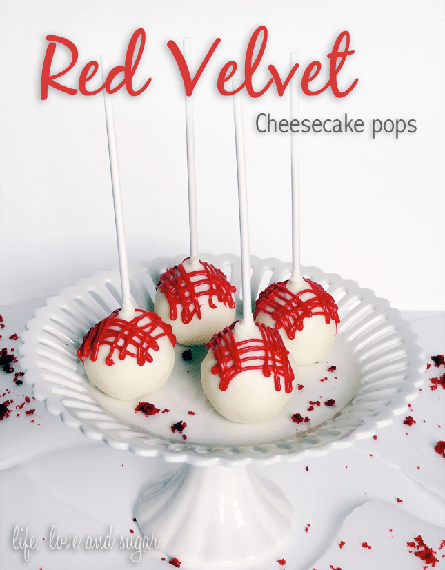 Four Cheesecake Pops on a Cake Stand with Some Red Velvet Cake Crumbs