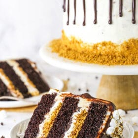 two slices of cake with full cake in background