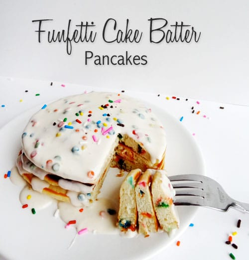Funfetti Cake Batter Pancakes on a white plate with a fork removing a bite