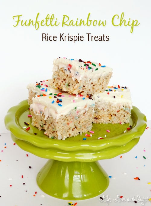 image of stack of Funfetti Cake Batter Rice Krispie Treats with Rainbow Chip Icing on green cake stand