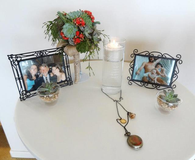 framed photos on table