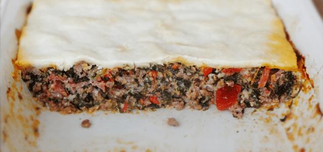 close up image of Three Meat Italian Pie in white casserole dish
