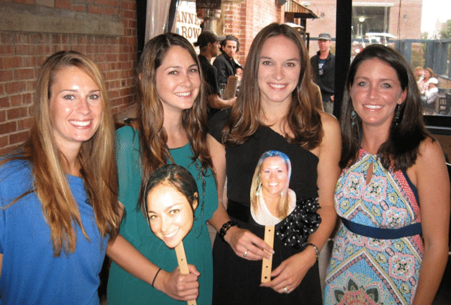 Lindsay and group of girls holding photos on sticks