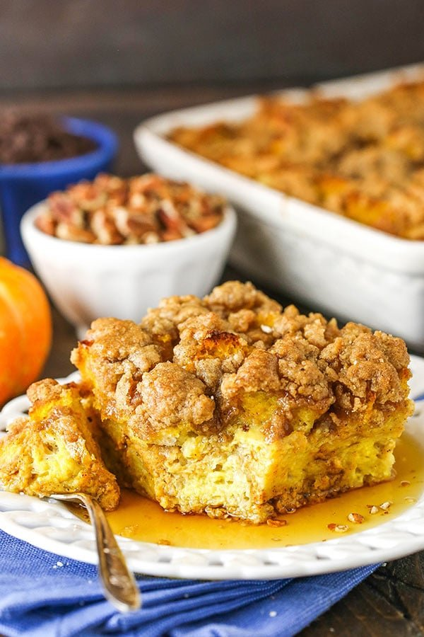 overnight pumpkin baked french toast casserole slice with bite taken