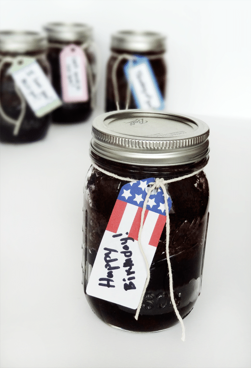 Cake in a sealed mason jar with a Happy Birthday tag on it