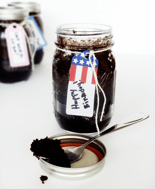 Cake in a mason jar with a birthday tag on it and a fork removing a bite
