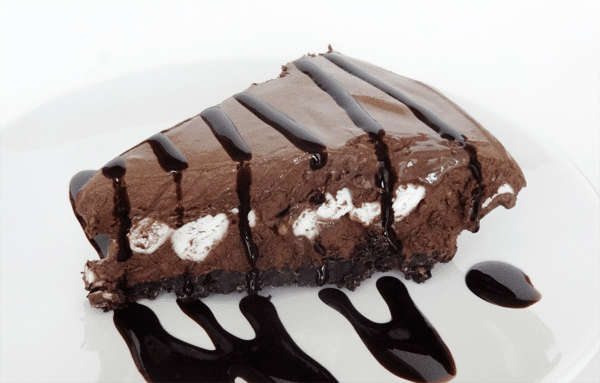 Close up of a slice of Hot Chocolate Ice Cream Pie with chocolate sauce drizzled on top