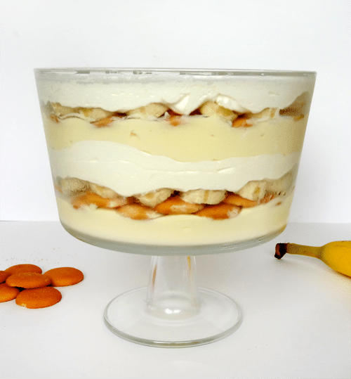 Side view of Banana Pudding with vanilla wafers and cool whip layered in a glass trifle bowl