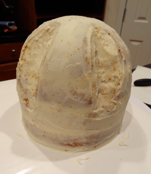 The Circular Hat Cake Base with a Crumb Coat of White Frosting