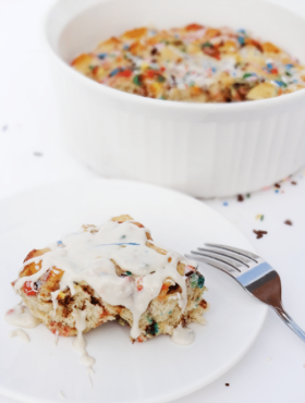 Funfetti Cake Batter Cinnamon Roll Casserole {with Rainbow Chip Icing} with casserole in background
