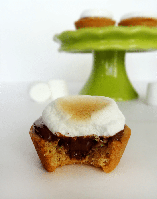 A Peanut Butter Nutella Cup with Marshmallow on top and a bite missing