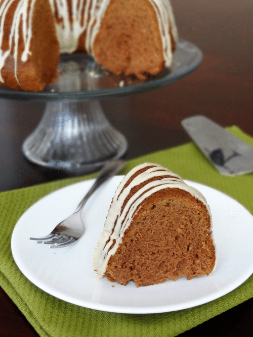 A slice of Baileys Irish Cream Cake on a white plate with a fork