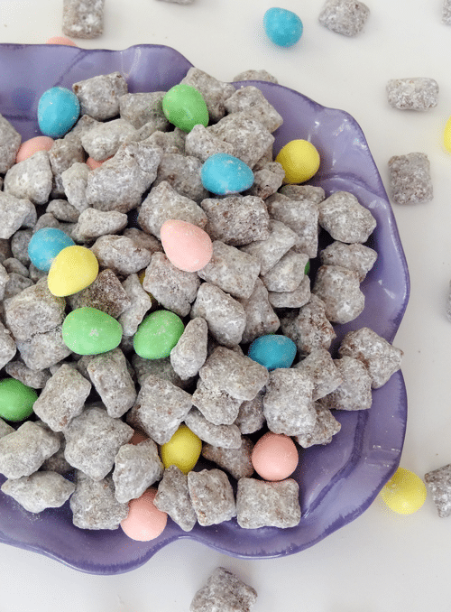 Reese's Easter Eggs and Puppy Chow in a purple bowl