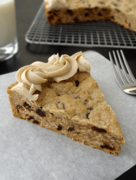 Thick and Chewy Oatmeal Raisin Cookie Cake With Cinnamon Maple Icing slice