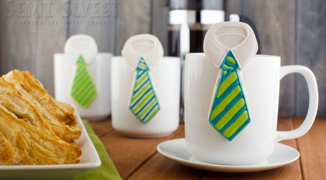Three Hanging Neck Tie Cookies Propped up Onto Three White Mugs