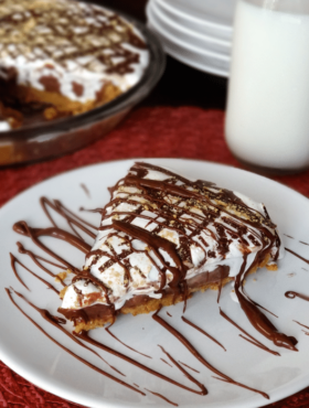 A slice of Nutella, Peanut Butter and Marshmallow Pie on a white plate