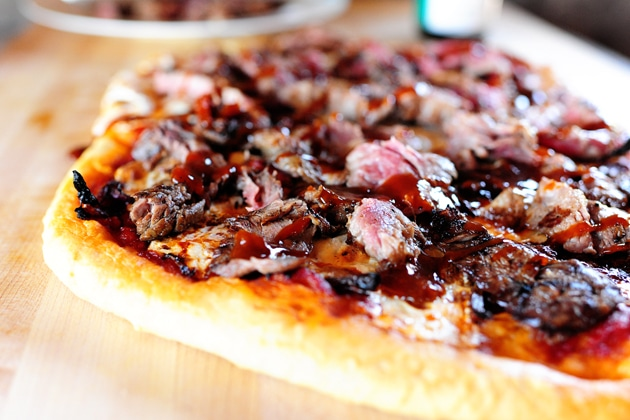 A Close-Up Shot of a Steakhouse Pizza on a Wooden Table