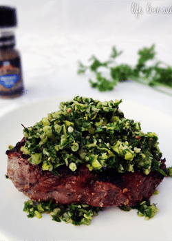 Chimichurri on steak close up