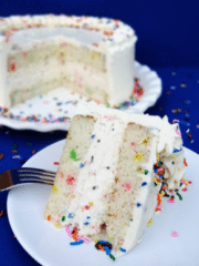 Funfetti Cake Batter Ice Cream Cake slice on white plate