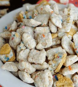 Golden Birthday Cake Oreo Puppy Chow in white bowl close up
