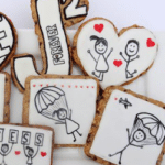 Seven Oatmeal Chocolate Chip Cookies Decorated with Royal Icing on a Plate