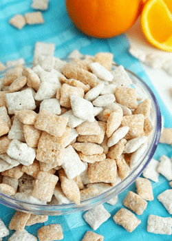 Orange Creamsicle Puppy Chow in glass bowl