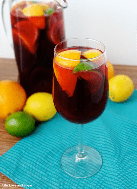 Easy Red Wine Sangria in a pitcher and a glass