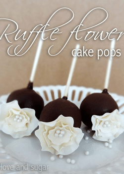 Ruffle flower cake pops on white plate