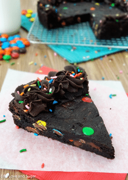 Triple Chocolate Cookie Cake slice on wax paper
