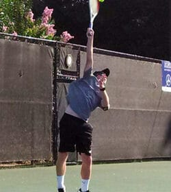 Ian serving a tennis ball. Love our family life.
