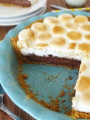 Smores Chocolate Pie slice in blue pie plate