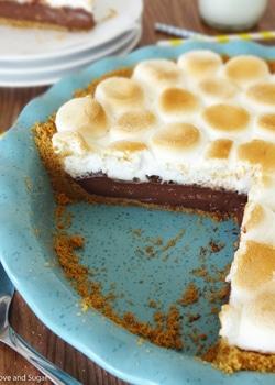 Smores Chocolate Pie slice in blue pie plate