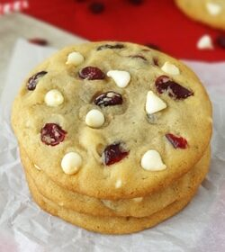 Cranberry white chocolate chip cookies stacked close up