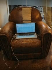 Laptop sitting on leather chair