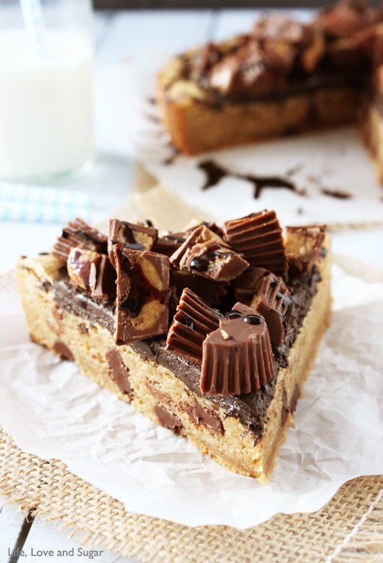 Reese's Peanut Butter Chocolate Chip Cookie Cake slice on parchment