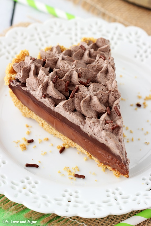 A piece of Baileys Chocolate Pie with layers of chocolate filling, ganache and whipped cream