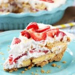 A slice of No Bake Strawberry Lemon Cookie Pie on a Plate