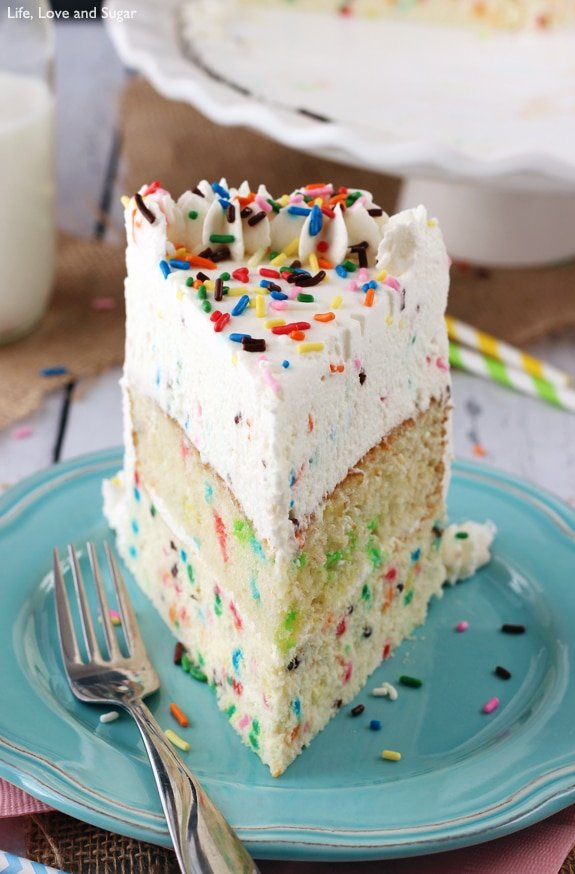 Funfetti Millionaire Cake - A layer of Funfetti cheesecake, Funfetti cake, and Funfetti mousse!