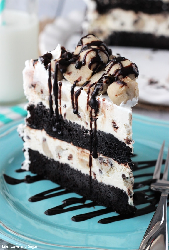 A Piece of Chocolate Chip Cookie Dough Ice Cream Cake on a Blue Plate
