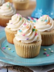 Perfect Moist and Fluffy Vanilla Cupcakes on blue plate