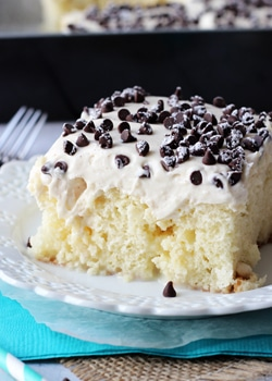 A slice of Cannoli Poke Cake on a white plate