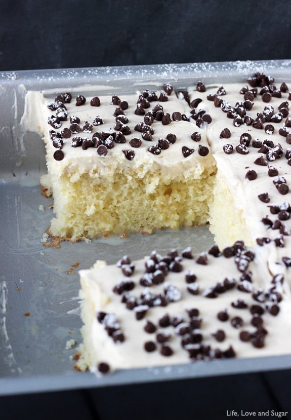 Cannoli Poke Cake - vanilla cake topped with cannoli filling icing!