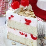 A Slice of Cherry Almond Amaretto Ice Cream Cake on a white plate