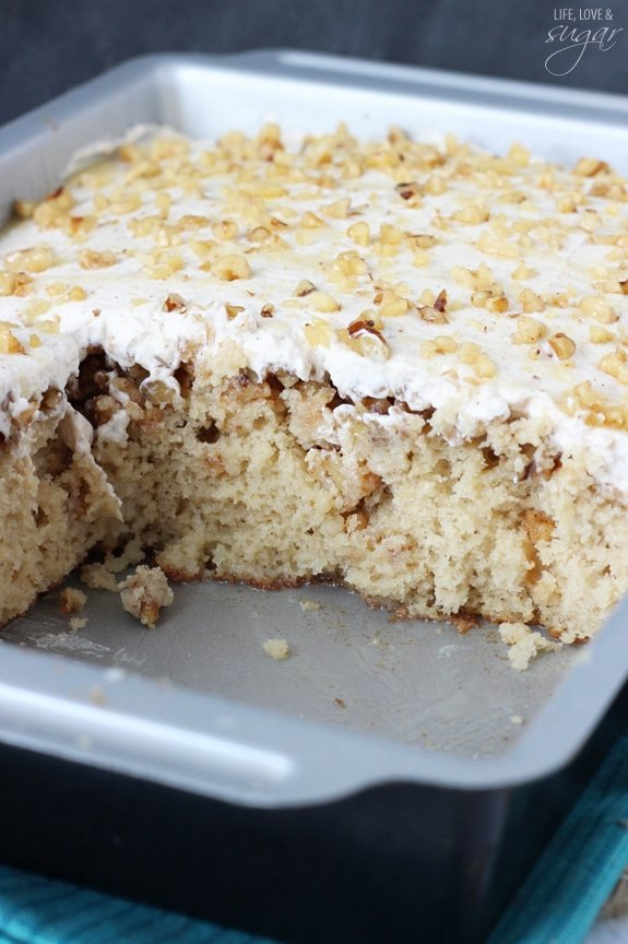 Baklava Poke Cake in a pan with several pieces missing