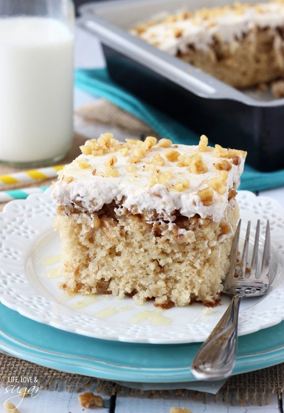 A piece of Baklava Poke Cake on a plate with a fork