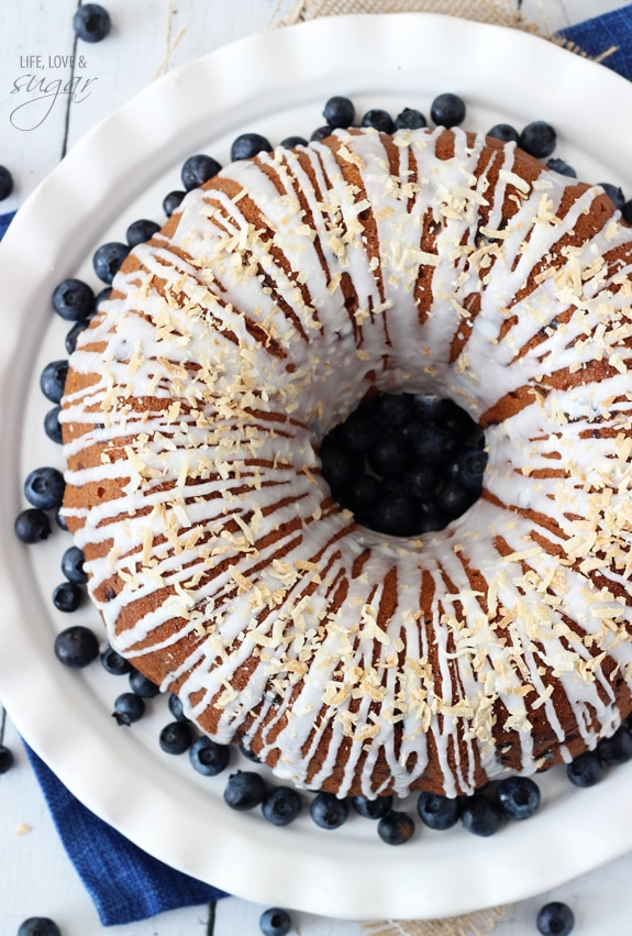 Overhead view of Blueberry Coconut Bundt Cake on a plate with blueberries