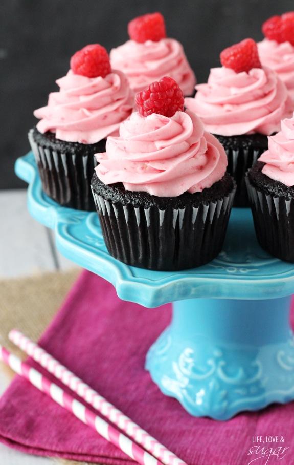 Raspberry Chocolate Cupcakes on a blue pedestal