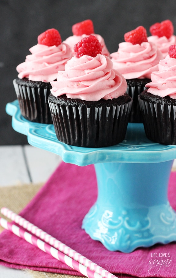 Raspberry Chocolate Cupcakes on a blue stand