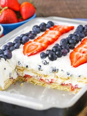 full image of Strawberry and Blueberry Cheesecake Icebox Cake with slice removed